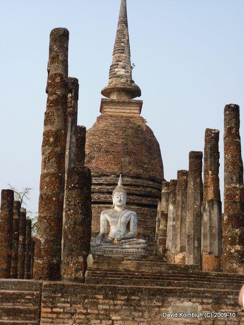 Sukhothai Buddha before an ancient Stupa